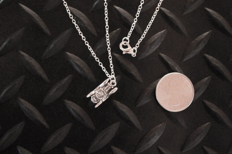 Antique Car Necklace with quarter for scale