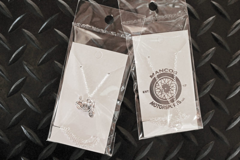 Little Silver Motorcycle Necklace in packaging
