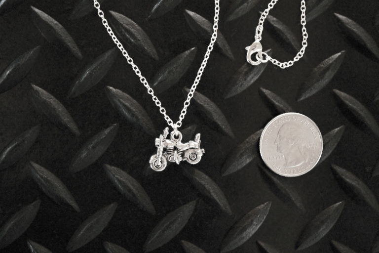 Little Silver Motorcycle Necklace with quarter for scale