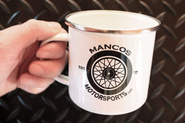 Mancos Motorsports Logo Camper Mug in hand for scale