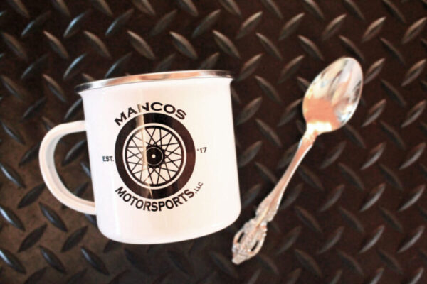 Mancos Motorsports Logo Camper Mug with spoon for scale